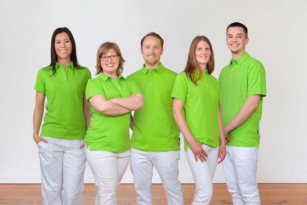 Praxisfoto mit lachendem Team für Osteopathie in Potsdam
