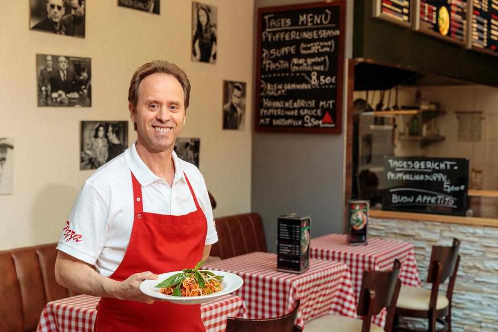 Portrait eines Inhabers einer Pizzeria