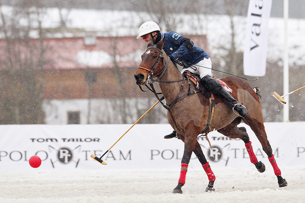 Polo player chasing the ball during the match