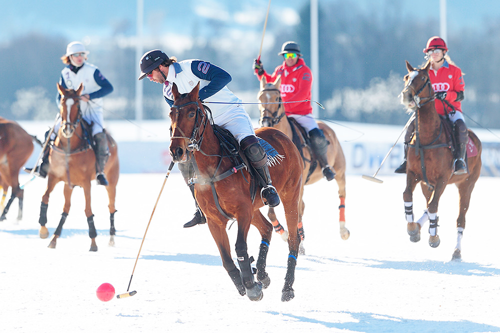 Polo player playing the red ball during the game